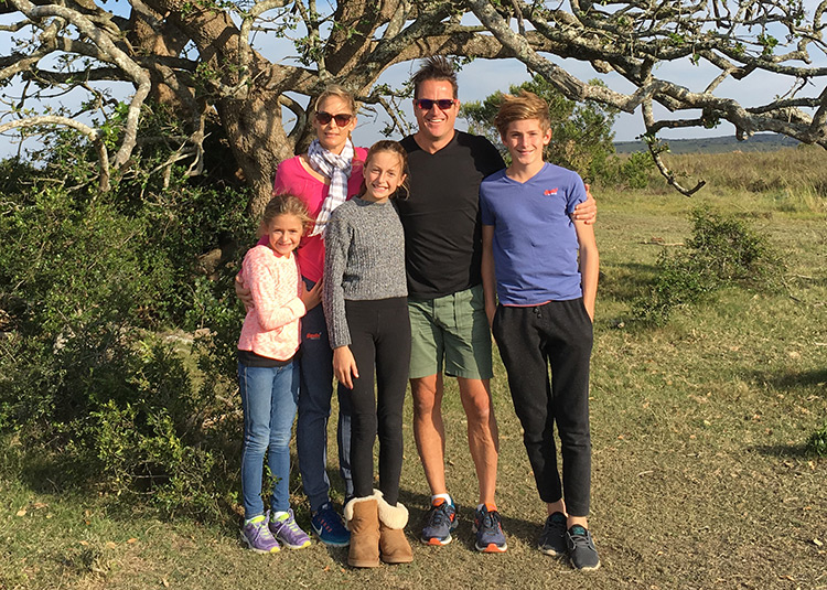 Bianca Shapiro and her family standing under a tree in Africa
