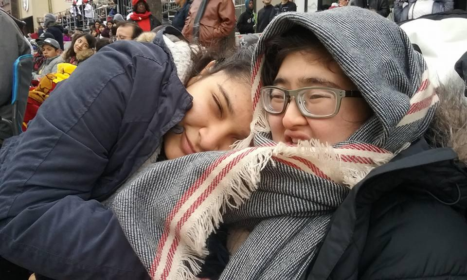 Dian with her sister hugging her