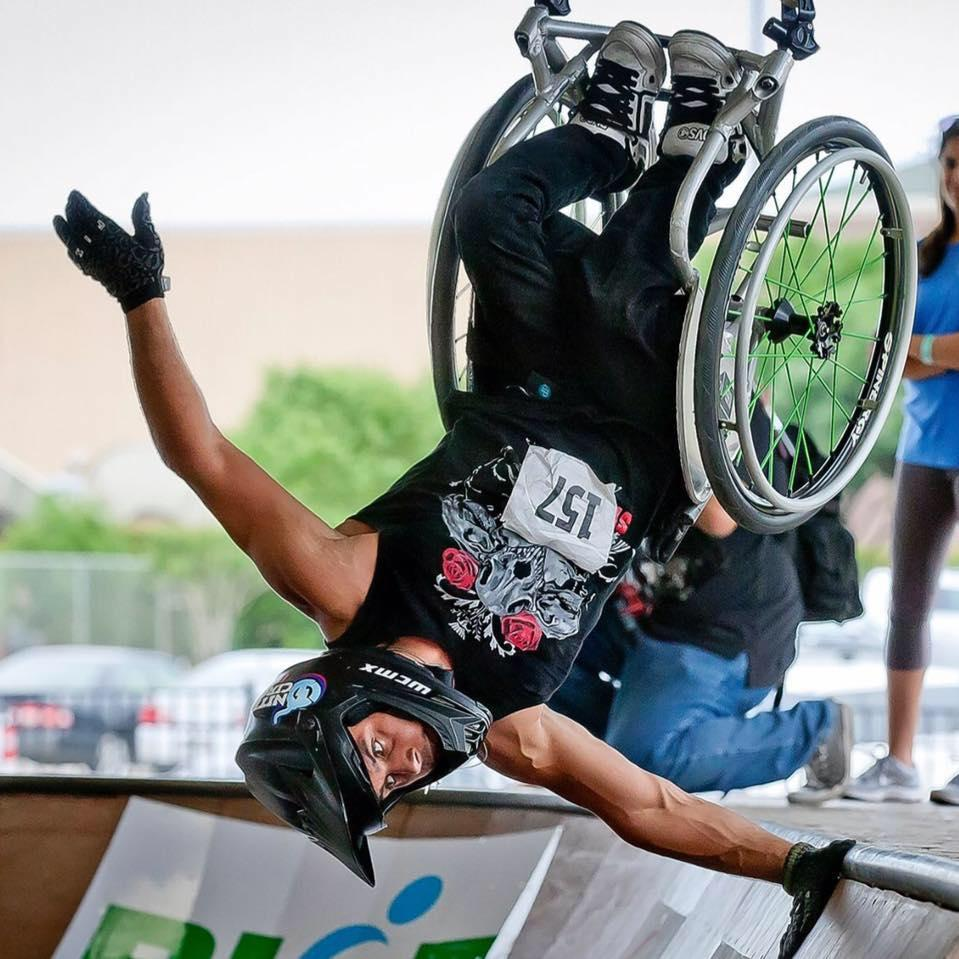 Aaron fotheringham in midback on his wheelchair at a skate ramp