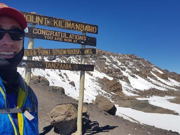 Steve standing at Stella point on Mount Kilimanjaro