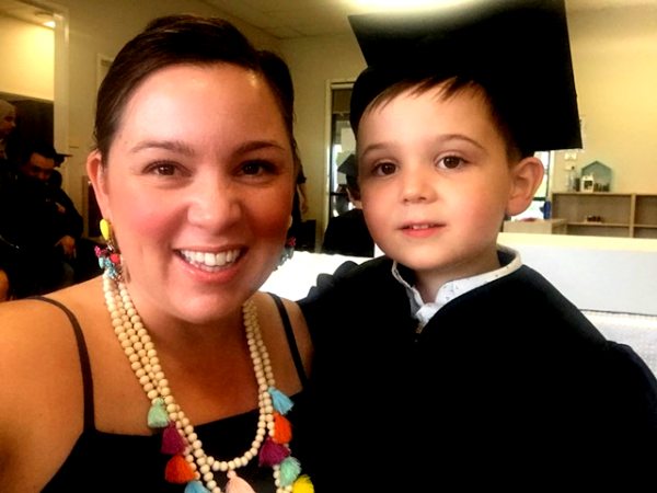 Emily smiling with Ollie at Graduation