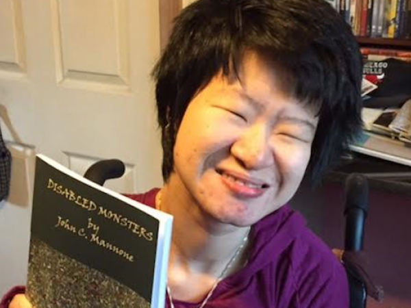 Erin Kelly smiling while holding one of her books