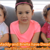 Maddy and her sisters sitting on a couch